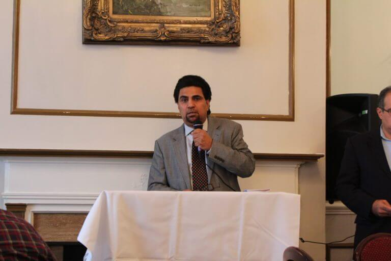Salman Aftab of the American Muslim Task Force PAC introduces Christopher Kennedy, the son of the late U.S. Senator Robert F. Kennedy, at a governor's candidates forum Sept. 16, 2017 at Reza's restaurant in Oak Brook. Photo courtesy of Ray Hanania