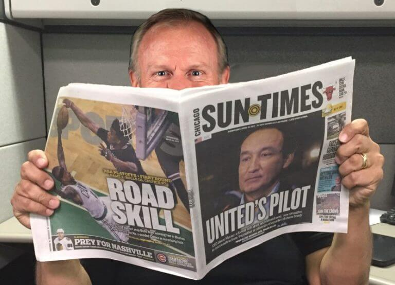 Governor Bruce Rauner holding a the Chicago Sun-Times, a newspaper he controls and influences to hammer Democrats and his critics. Photo meme courtesy of Ray Hanania