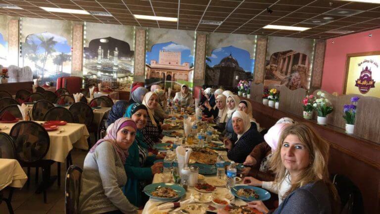 Women enjoying a dinner at Qasr al-Deyafah restaurant