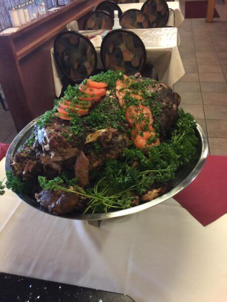 Roast lamb plate at Qasr al Deyafah restaurant