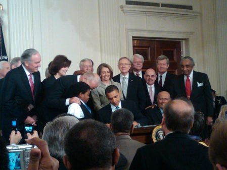 Barack Obama signing the Patient Protection and Affordable Care Act at the White House (Photo credit: Wikipedia)