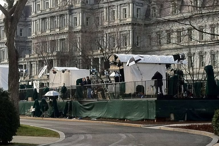 Semi-permanent setup of press corps on the west end of the north White House lawn, from where live media broadcasts with the White House are typically delivered. Photo courtesy of Wikipedia