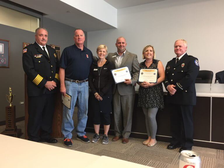 (From left) Chief Schofield, cardiac victim Raymond Morrissey, Lisa Morrissey, Lifetime Employees Jason Fox and Jen Strickland, and Lt. Mark Duke.