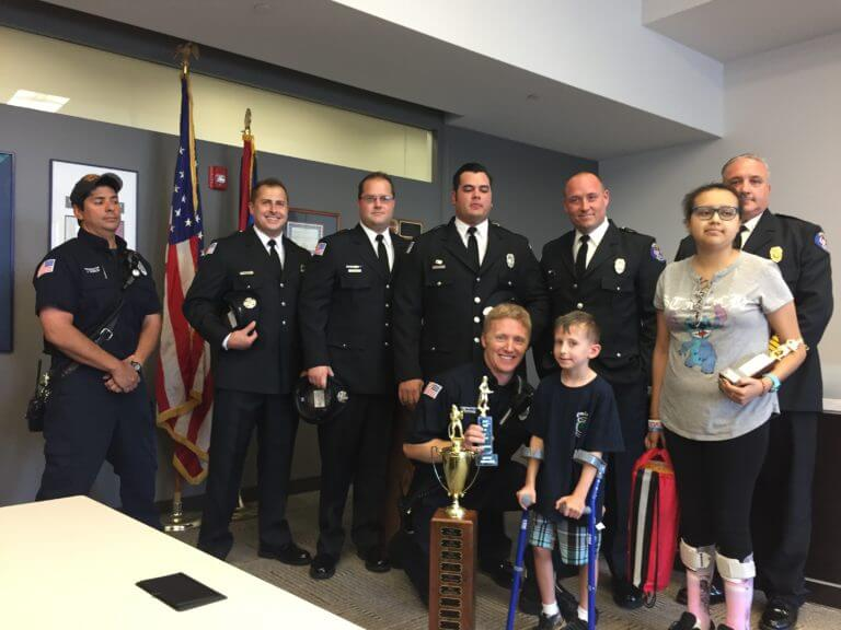 Presentation of OFPD 1st Place Trophy from FIRE UP A CURE 2017 6th Annual event to help fund pediatric cancer research and help area families affected by pediatric cancer.