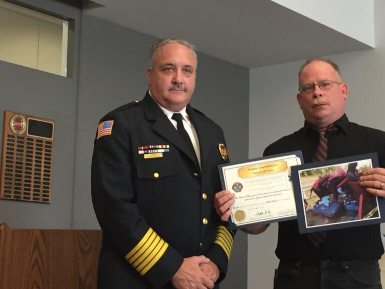 Citizen Robert Schelfelbein displays the certificates he received from OFPD Fire Chief Mike Schofield.