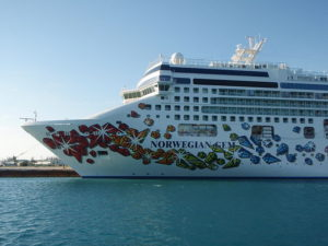 "The ""Norwegian Gem"", a cruise ship operated by the ""Norwegian Cruise Line"" and built in Papenburg, Germany 2006-2007. The photo was taken in Freeport, Bahamas at the 13th of March, 2008.  (Photo credit: Wikipedia)"