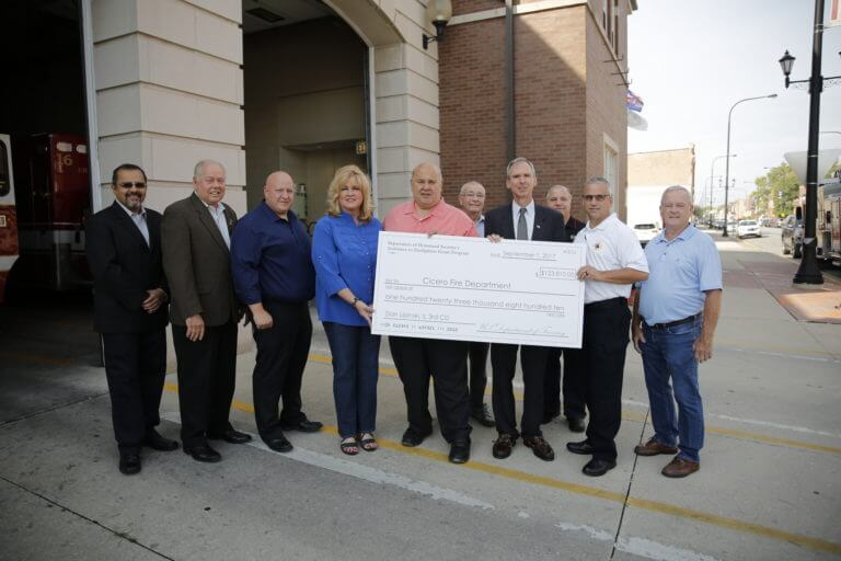 Congressman Dan Lipinski presents the Cicero Fire Department a check for $123,810 received through the Department of Homeland Security's Assistance to Firefighters Grant Program. The grant will help purchase 2,600 combination carbon monoxide and smoke detectors. Photo courtesy of the Town of Cicero