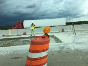 Road construction concrete pavement worker. Photo courtesy of Ray Hanania