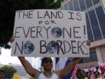 Immigrant rights march for amnesty in downtown Los Angeles, California on May Day, 2006. (Photo credit: Wikipedia)