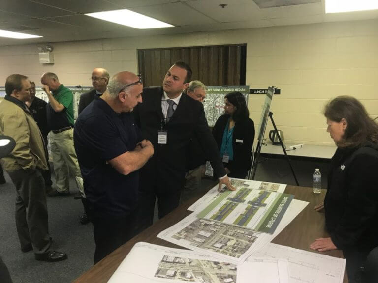 Carlos Feliciano (center) of IDOT discusses plans for 55th Street and LaGrange Road with Luke Castrogiovanna of Terry Plumbing. (Photo by Steve Metsch)