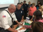 CERT trainees take instruction from Lt. Bill Leddin and Engineer Tom Rafferty on how to properly apply a tourniquet to an injured limb in a 2016 training. Photo courtesy of the Orland Fire Protection District