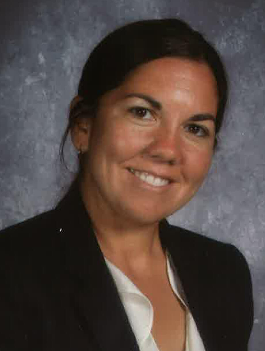 Jennifer Tyrrell as Principal of Sandburg High School