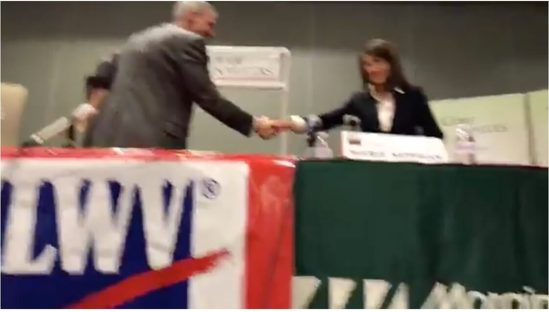 Congressman Dan Lipinski and challenger Marie Newman shake hands following hour-long forum hosted by the League of Women Voters at Moraine Valley Community College on Feb. 21, 2018