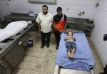 The body of 4 year old Rahaf Hassan is prepared for burial in a Gaza Mortuary. Rahaf was murdered along with her mother, and her mother's unborn baby by an Israeli military terrorist airstrike against civilian targets in Zeitoun, Gaza Strip early Sunday morning, Oct. 11, 2015. Copyright (C) 2015 Mohammed Asad. All Rights Reserved.