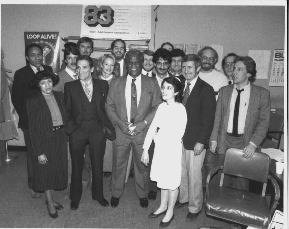 Harry Golden Jr., stands front-and-center with Mayor Washington and members of the Chicago Press that covered City Hall full and part time.