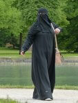 Woman in a berqa (burka) By Hans Braxmeier (pixabay) [CC0 or CC0], via Wikimedia Commons