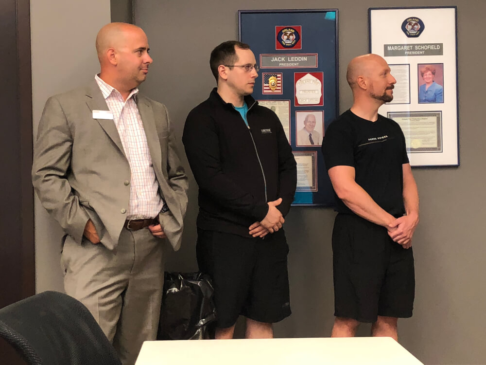 Lifetime Team Members: Jason Fox, Cooper Garland and Jerome Jasper listen as Sanocki describes his emergency experience. Photo courtesy of the OFPD