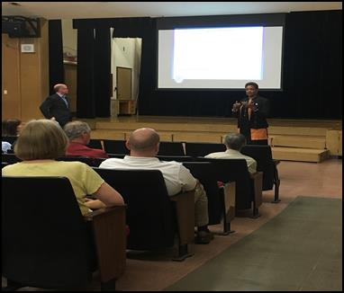 Rep. Camille Lilly Sen Don Harmon meet with district residents on balanced budget efforts in Springfield at a community forum hosted in June 2018