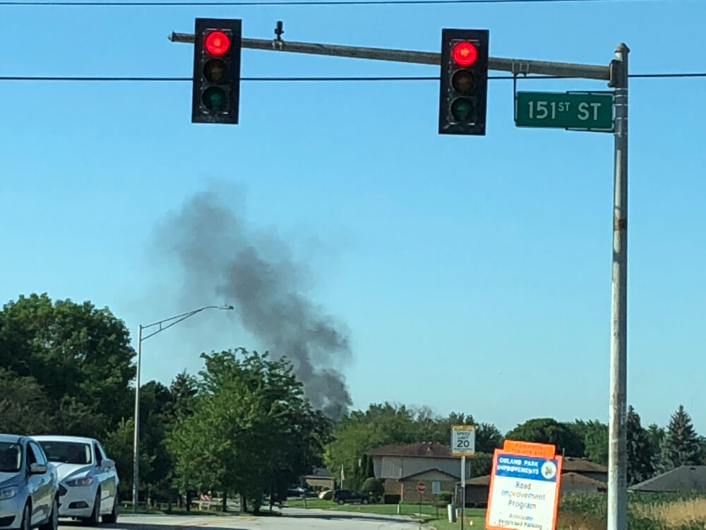Plume of black smoke rises from truck fire adjacent to the rear entrance of the Walmart Super Center store at 9265 159th Street in Orland Hills. Photo courtesy of Ray Hanania