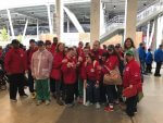 Pictured: Hurley (right) with athletes at the Special Olympics opening ceremony at Soldier Field.