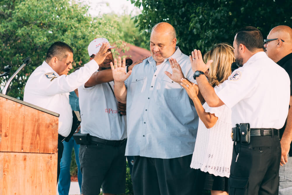 "Town of Cicero President Larry Dominick joins in a prayer at the Cicero ""Day of Prayer"", attended by hundreds of Cicero Residents who have helped the town stop street gang violence.  Photograph by Juan Mojica / JAM1PHOTO"