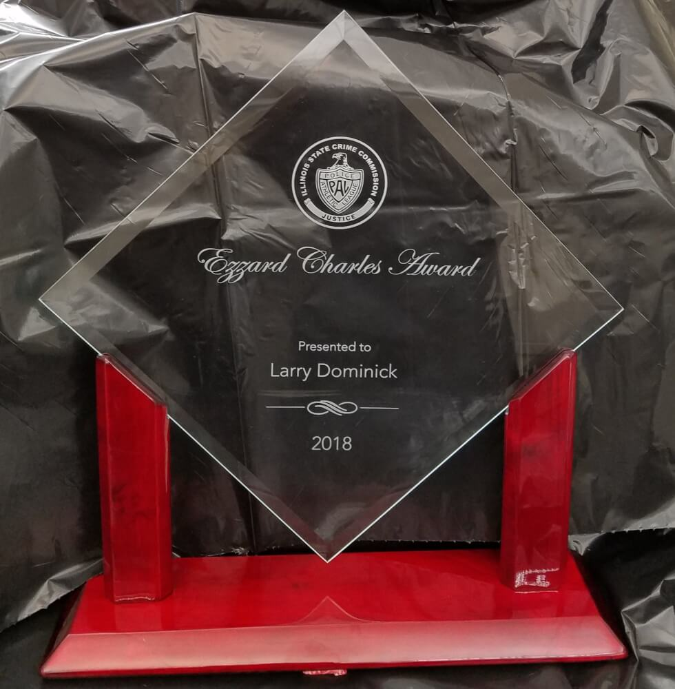"""The Illinois Crime Commission and Police Athletic League presented President Dominick with the Ezzard Charles Award, named after the former World Heavyweight Championship Boxer, Ezzard Mack Charles, known professionally as """"The Cincinnati Cobra."""""""
