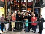 Landek helps cut ribbon on remodeled McDonalds
