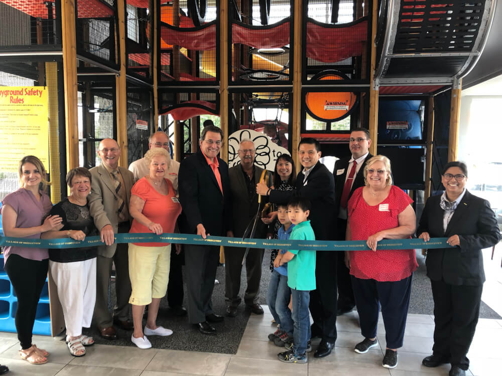 Bridgeview McDonald's owner operator Johnny Tom (holding scissors), Bridgeview Mayor Steven Landek, Bridgeview trustees, Bridgeview Chamber of Commerce members and restaurant staffers celebrate the grand reopening of the remodeled location at 8611 S. Harlem Ave. (Supplied photo)