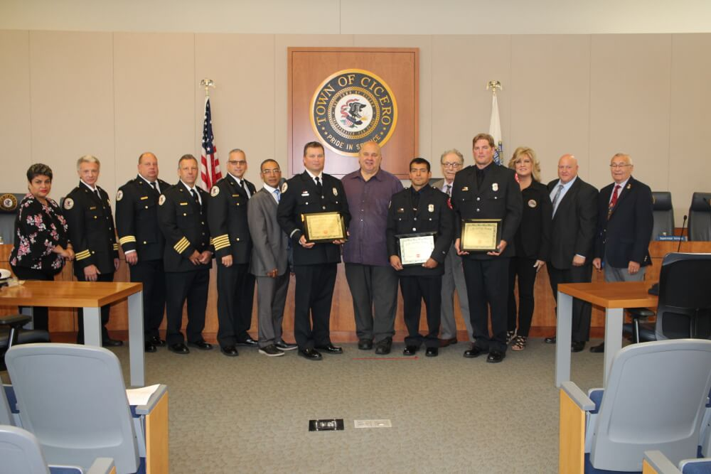Town President Larry Dominick and Fire Chief Dominick Buscemi presented Life Saving Awards to three Firefighters and also to the members of the crew of Fire Truck #2, Lt. John Sochacki, Engineer Ken Pereyra and firefighter Joe Vertin during the Town of Cicero's regularly scheduled board meeting held on Tuesday Sept. 25, 2018 for saving lives at a fire at 1623 50th Court on August 19, 2018