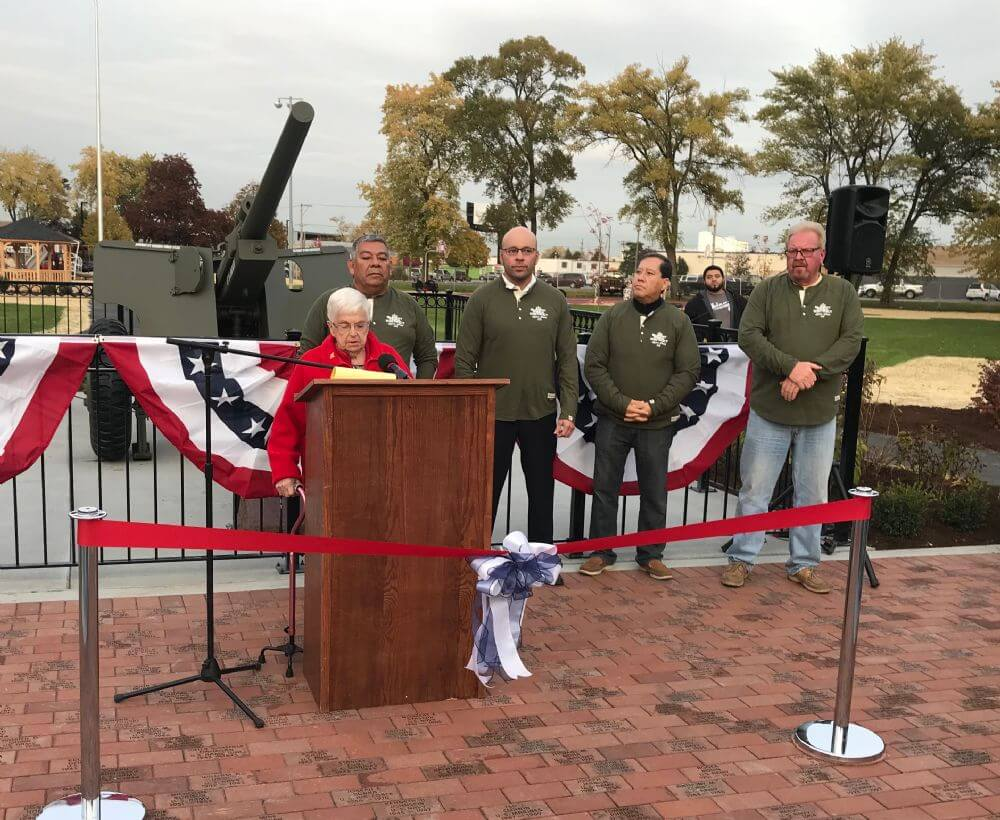 Summit Park Board President discusses the refurbished anti-tank gun that's a key part of Legion Park which was dedicated in a ceremony. (Photo by Steve Metsch)