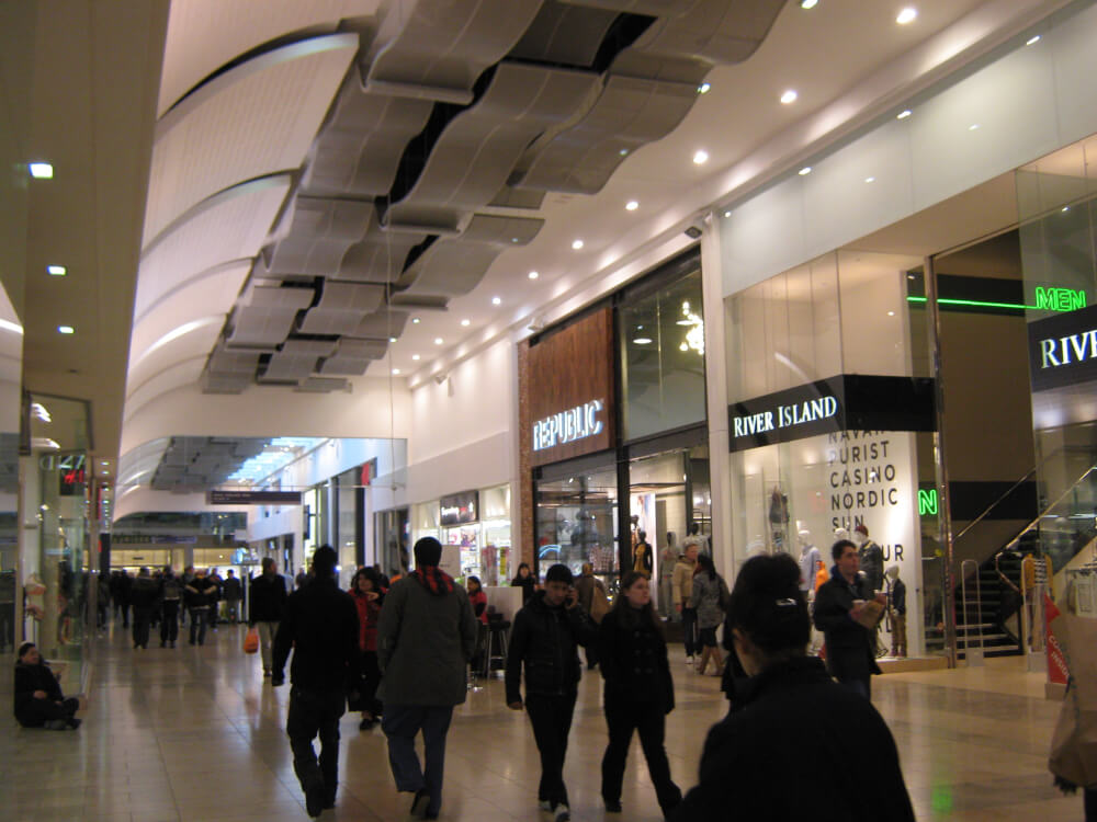 Men shopping in a shopping mall. Photo courtesy of Wikipedia