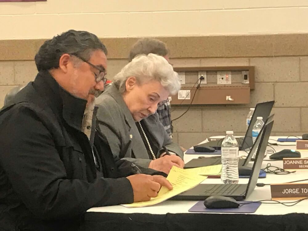 Lyons School District 103 board members Jorge Torres and Joanne Schaeffer, in a rare moment, agreed on a couple of votes Monday night. Photo by Steve Metsch.