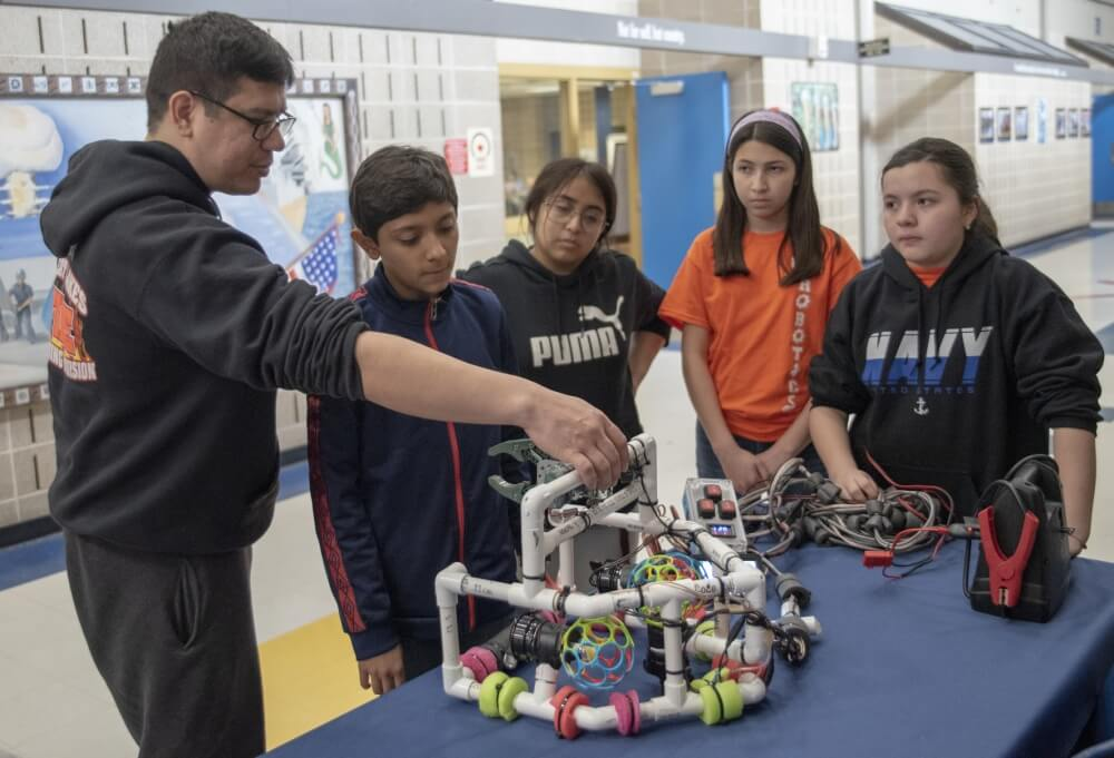 (April 6, 2019) Electrician's Mate 2nd Class Thomas Torrez reviews the build of an underwater remotely operated vehicle (ROV) with a group of competitors in the 2019 Navy Great Lakes SeaPerch competition at Recruit Training Command. The SeaPerch program provides students with the opportunity to learn about science, technology, engineering and mathematics (STEM) while building an underwater ROV as part of a science and engineering technology curriculum. More than 35,000 recruits train annually at the Navy's only boot camp. (U.S. Navy photo by Mass Communication Specialist 1st Class Spencer Fling)