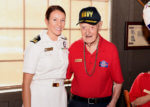 (SAN ANTONIO –Aug. 14, 2019) Lt. j.g. Kathleen Spyrnal of Oak Lawn, Ill., an Officer Programs operations officer assigned to Navy Recruiting District San Antonio (NRD), presented a certificate of appreciation to WWII Merchant Marine Ray Denison during an Alamo Honor Flight Breakfast held at a local Cracker Barrel Country Store.  Attended by other WWII veterans, the breakfast also served as a venue to celebrate Denison's 100th birthday. Denison, a long-time city resident and native of Eagle Pass, Texas, joined the U.S. Merchant Marines on Memorial Day 1942 and served till November 1945.  While serving, he held a reserve commission as a lieutenant junior grade in the U.S. Navy.  (Navy photo by Burrell D. Parmer, Navy Recruiting District San Antonio/Released)