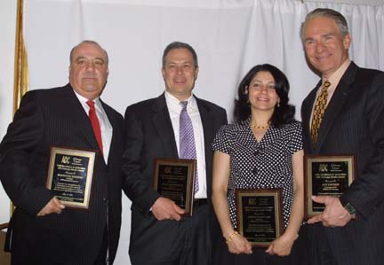 Mansour Tadros (left) joins Daily Herald Newspaper Columnist Burt Constable, American Arab journalist Amani Ghouleh, and WBBM TV Reporter Jay Levin in receiving Excellence in Journalism Awards from the Chicago Chapter of ADC in 2010