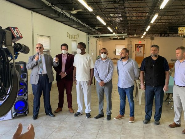 Dr. Willie Wilson(3rd from left) with Hassan Nijem and Mazen Dola and members of the Arab American community receive a donation of face masks from Dr. Willie Wilson and the Willie Wilson Foundation on Monday June 15, 2020 at the Palestine Club Center located at 7701 W 87th Street in Bridgeview.