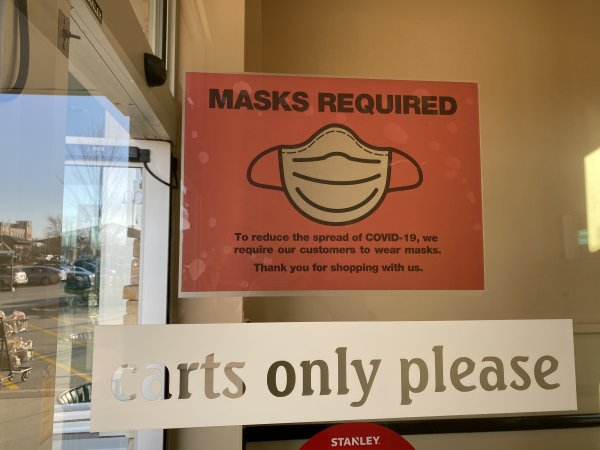 Face masks required sign posted by Mariano's in Orland Park. Photo courtesy of Ray Hanania