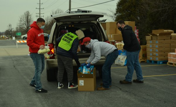 Orland Township Trustee Antonio Rubino (left) loads holiday meal items into residents' vehicles. Photo courtesy of Orland Township