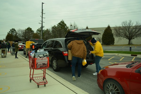 Orland Township volunteers load gifts into residents' vehicles. Photo courtesy of Orland Township
