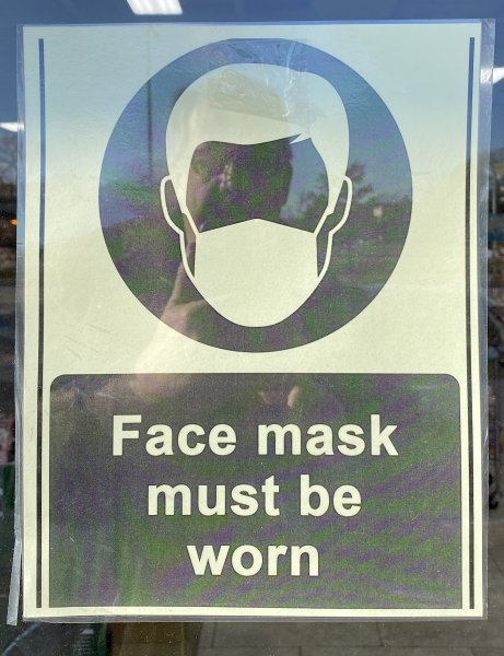 Face Mask must be worn sign posted at Orland Park store entrance. Photo courtesy of Ray Hanania
