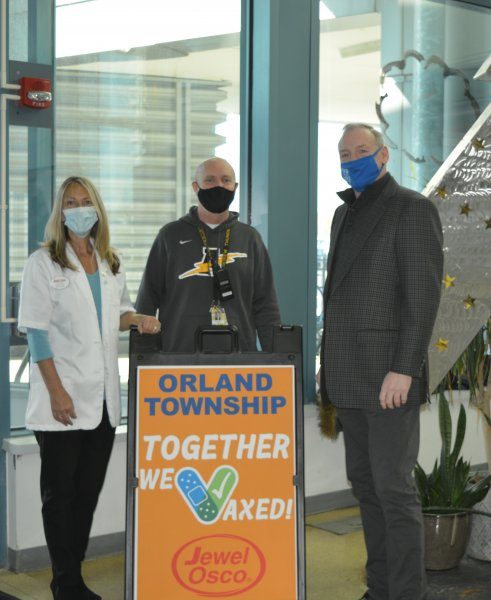 Orland Township Supervisor Paul O'Grady (right) with Christina Ruth Dion, Osco Pharmacist and Coordinator of the Jewel Osco-Orland Township vaccine event and Mike Murphy, Head Dean at Andrew High School. Photo courtesy of Orland Township