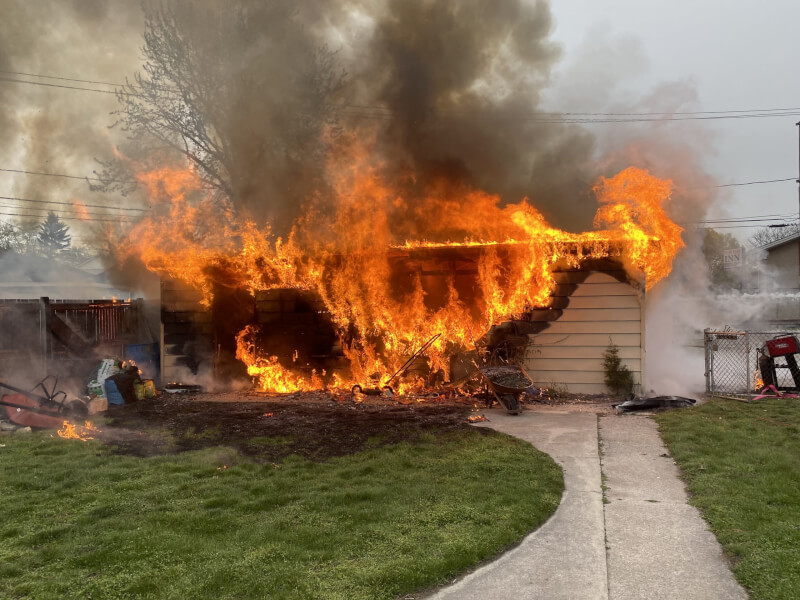 One hurt in garage fire