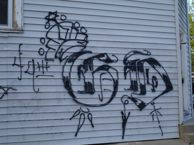 Street gang graffiti, Chicago. Courtesy Wikipedia Attribution-ShareAlike 4.0 International (CC BY-SA 4.0)