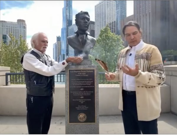 Pictured right: Dennis Downes (left) and Andrew Johnson (right) of the Native American Chamber of Commerce at last year's August DuSable Commemoration