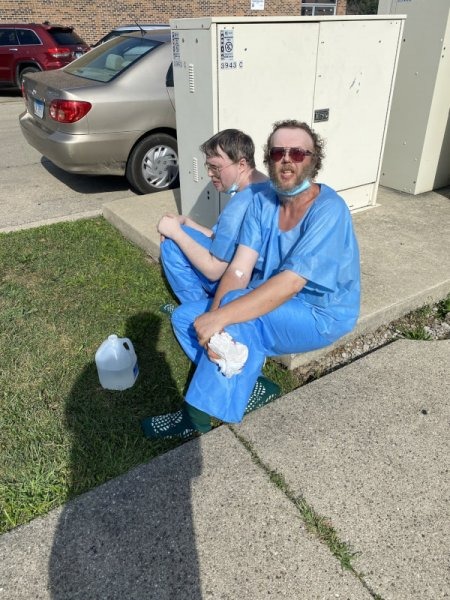 Brothers Michael Lelko, 56, (foreground) and John Lelko, 51, (bacK) told Lyons police that they buried in their back yard their mother, who died when their sister pushed her down some stairs in 2015. They said their sister died in 2019 and they buried her in the backyard of their Lyons home at the 3900 block of Center Avenue. Photo courtesy of Ray Hanaia