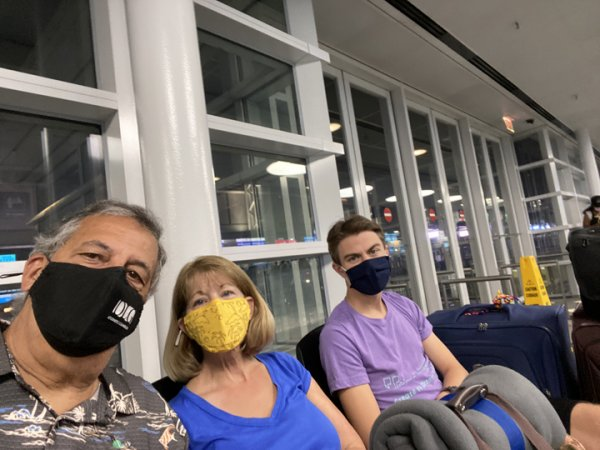 Ray Hanania, Alison and Aaron wearing face masks at O'Hare Airport waiting for voyage to the Grand Reserve Paradisus Palma Real hotel in Punta Cana, Dominican Republican. Photo courtesy of Ray Hanania