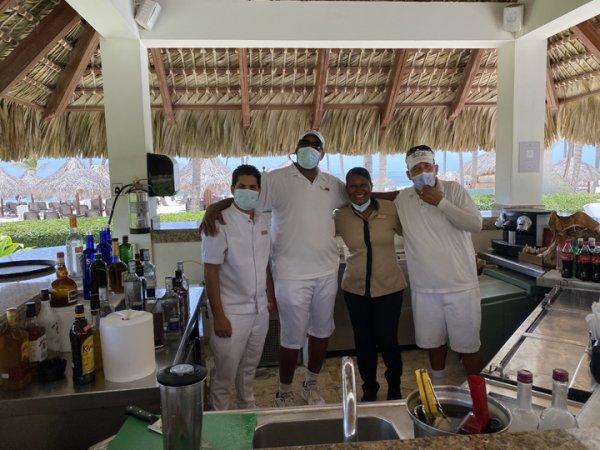 Wily Mercado, Pedro, Wanda and Martin at the private bar near the private pool at the Grand Reserve Paradisus Palma Real. Photo courtesy of Ray Hanania
