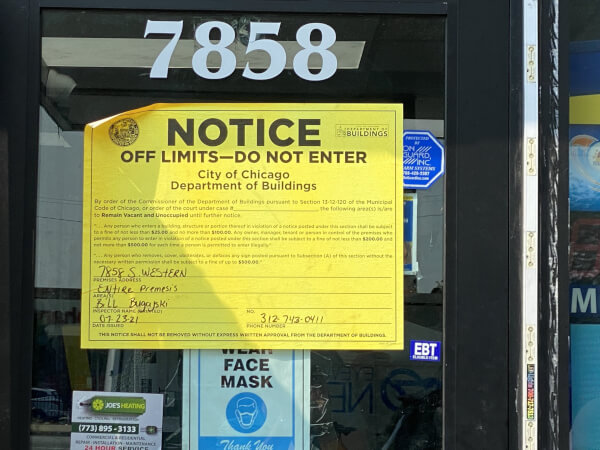 Closure sign placed by a Task Force of Police and Inspectors harassing Arab American owned businesses in Chicago. Photo courtesy of Ray Hanania