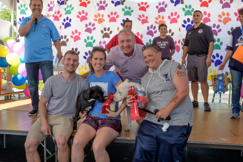 Supervisor Paul O'Grady on stage with pet contest winners at the 8th annual Pet-Palooza in 2019.