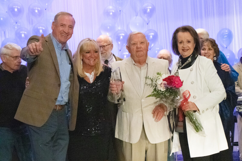 Orland Township Supervisor Paul O'Grady joined the 2021 Senior American Idol winner on stage to congratulate him. (L to R: Supervisor O'Grady, Senior Services Coordinator Marie Ryan, Senior Idol Edward Swanson, and his wife, Kathy Swanson)